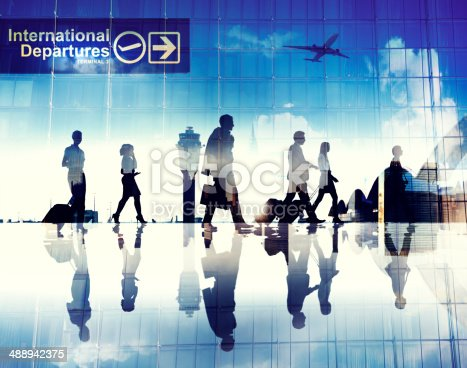 istock Silhouettes of Business People Walking in an Airport 488942375