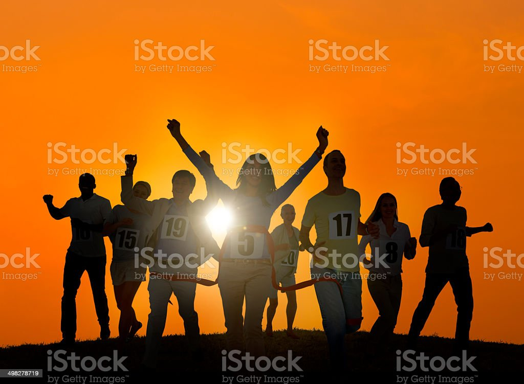 Silhouettes of Business People Winning Concept stock photo