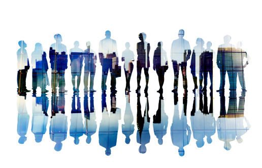 istock Silhouettes of Business People with Cityscape 488872919