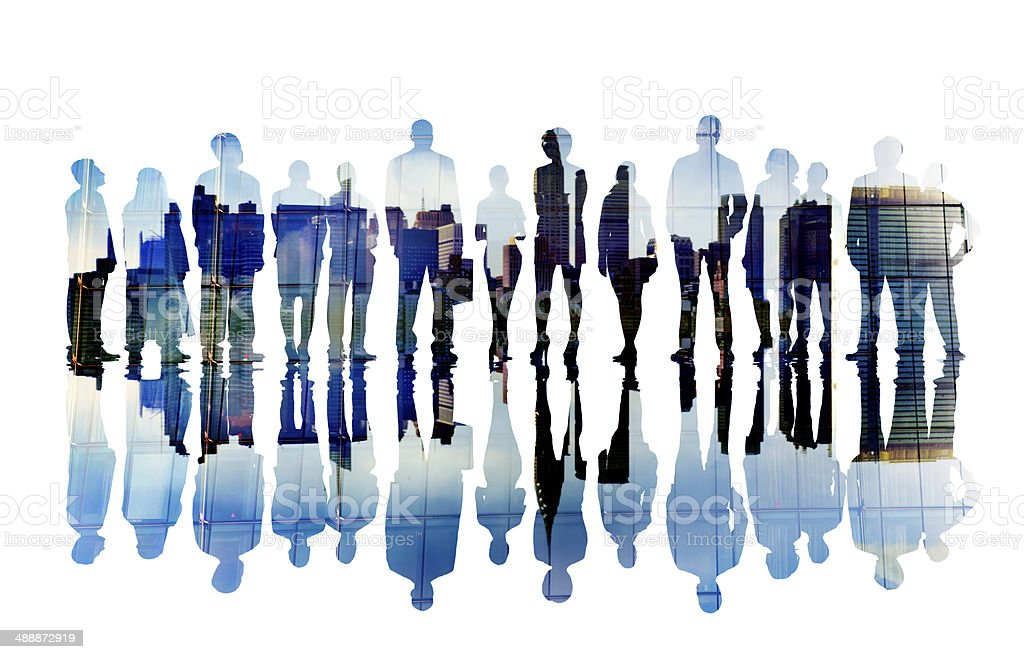 Silhouettes of Business People with Cityscape stock photo