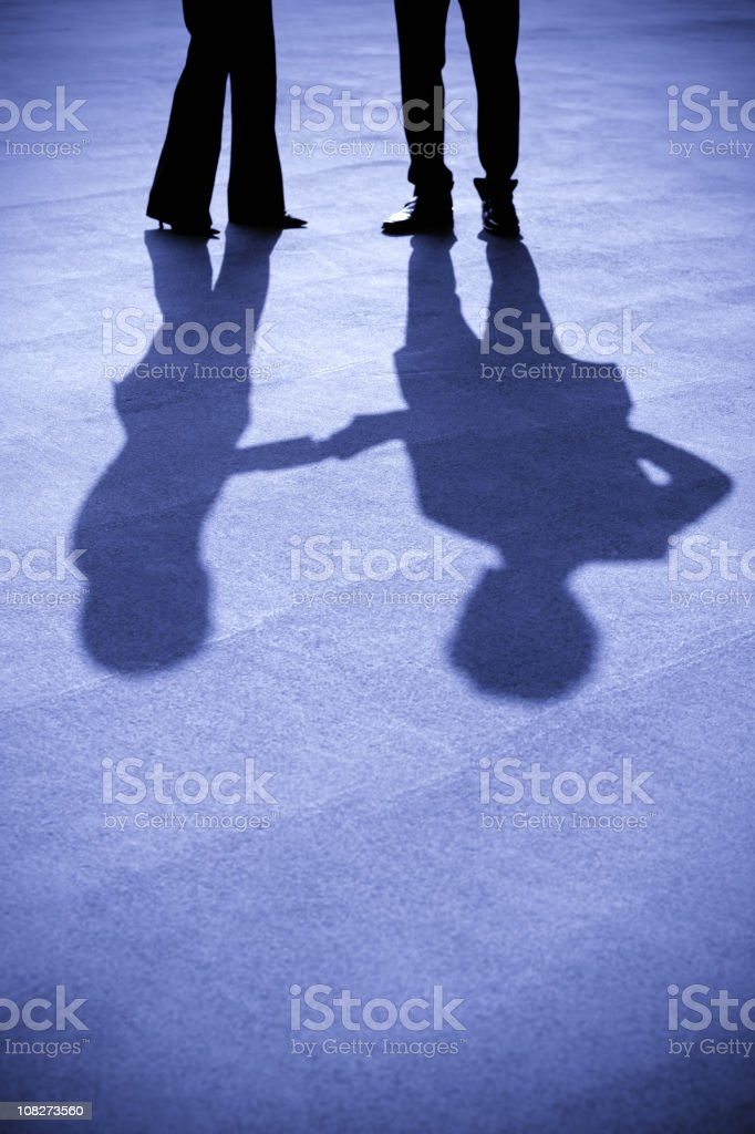 Silhouettes of businesswoman and businessman royalty-free stock photo