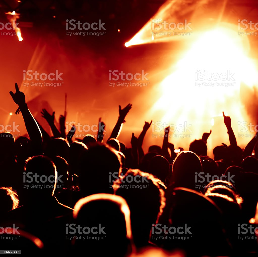 silhouettes of cheering concert crowd royalty-free stock photo