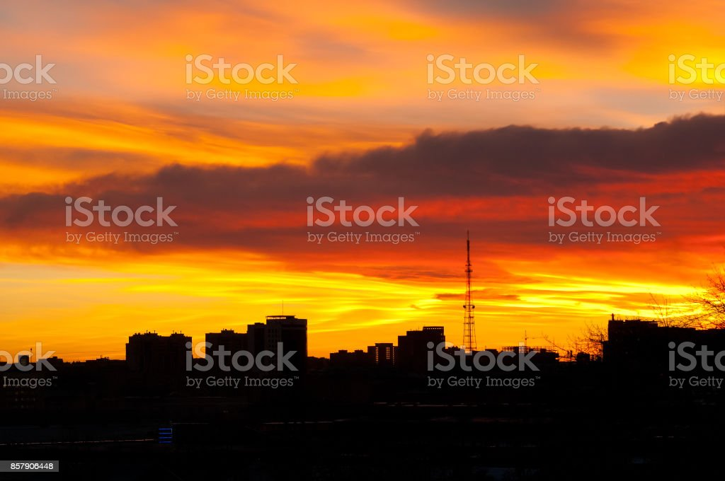 Silhouettes of city buildings against the background of an unusual bright sunset (the city of Chelyabinsk) stock photo