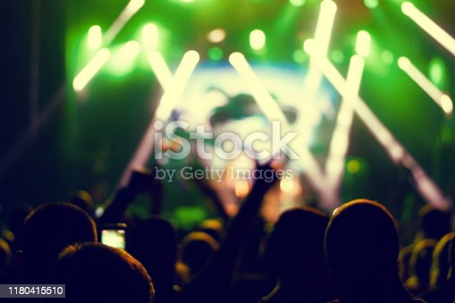 istock Silhouettes of concert crowd. 1180415510