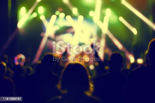 istock Silhouettes of concert crowd. 1181589191