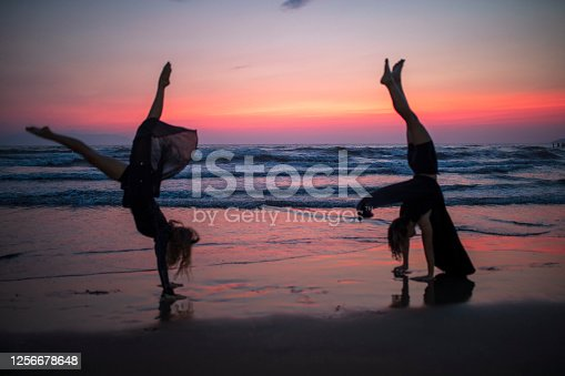 couple dancing at beach sunset
