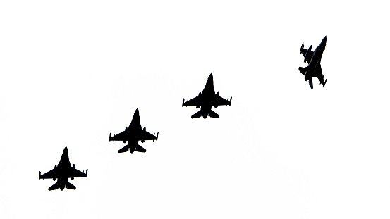 istock Silhouettes of fighter jets 610843084