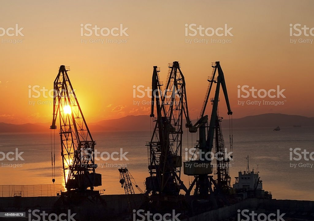 Silhouettes of gantries. Sunrise royalty-free stock photo