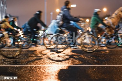 929609038istockphoto Silhouettes of group colorful cyclists on city road, illumination, abstract, motion blur, bike festival. Concept of modern lifestyle, healthy lifestyle, for background 1186913789