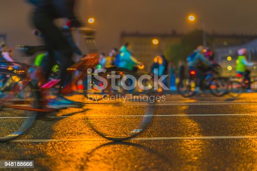 Silhouettes of group colorful cyclists on the city streets, abstract, motion blur. City bike festival. Concept of modern lifestyle, healthy lifestyle, for background