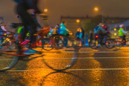929609038 istock photo Silhouettes of group colorful cyclists on city streets, abstract, motion blur, bike festival. Concept of modern lifestyle, healthy lifestyle, for background 948188666