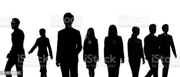Photo of Silhouettes of group of businessperson.