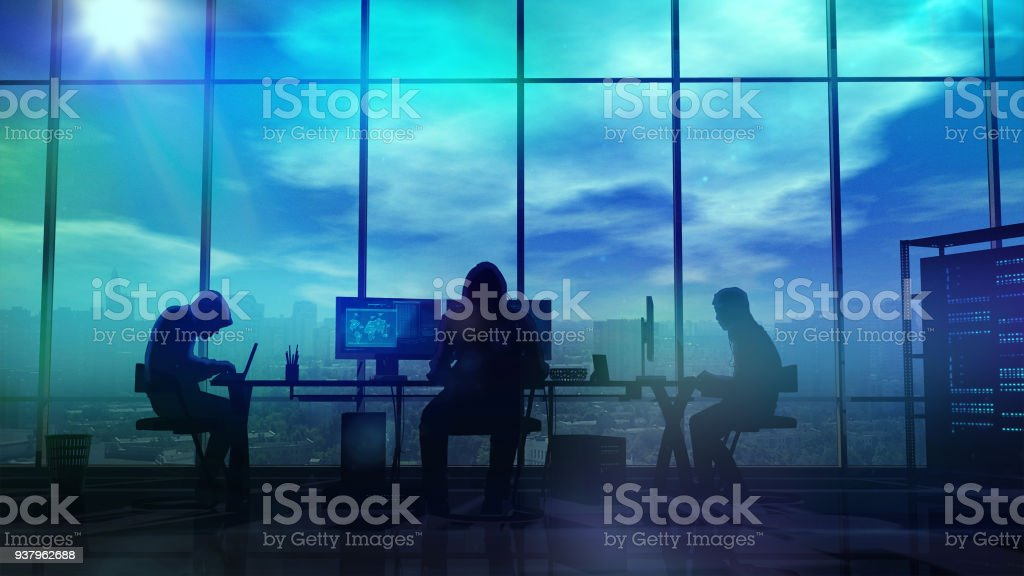 Silhouettes of hackers at work stock photo
