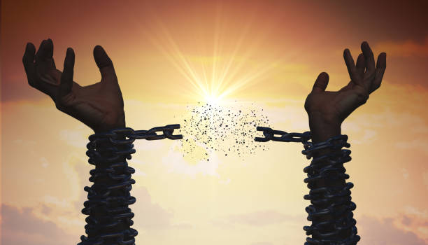 Silhouettes of hands are breaking chain. Freedom concept. Silhouettes of hands are breaking chain. Freedom concept. chain breaker stock pictures, royalty-free photos & images