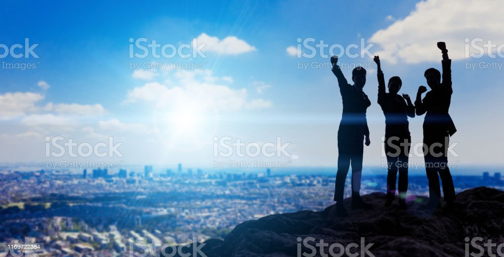 Silhouettes of happy businessperson. Success of business concept. - Royalty-free Achievement Stock Photo