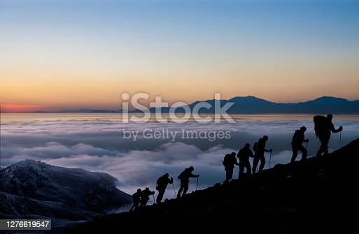 Silhouettes of hikers At Sunrise