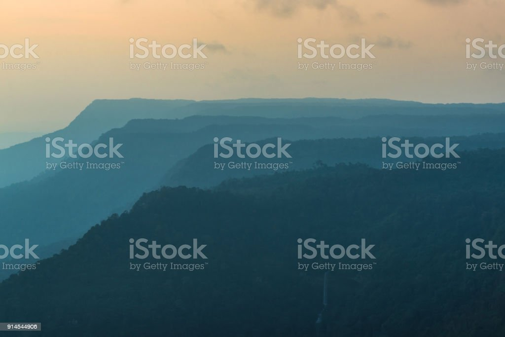 silhouettes of mountain in the evening.Bolaven plateau, Southern of LAOS stock photo