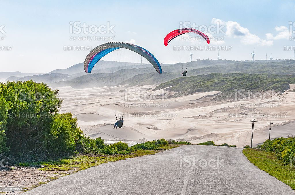 Silhouettes of paragliders in the air stock photo