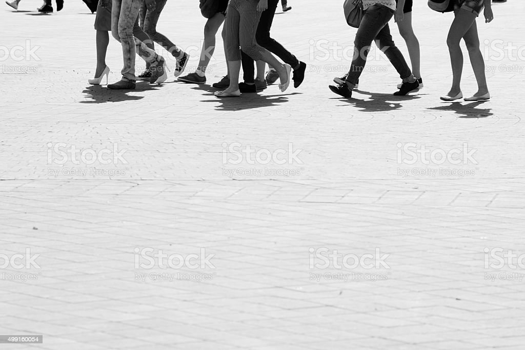 Silhouettes of pedestrians stock photo