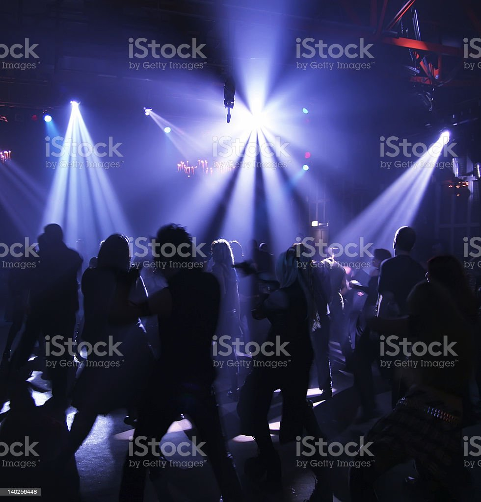 Silhouettes of people dancing in a dark night club royalty-free stock photo