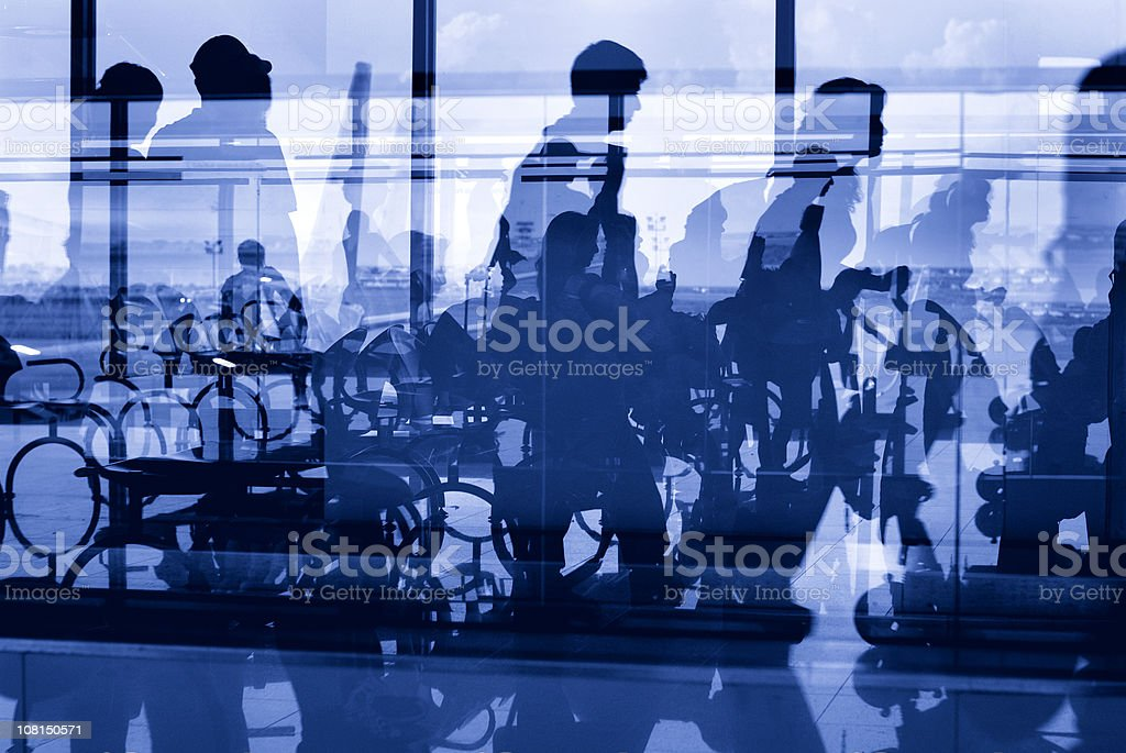 Silhouettes of People in Airport Window royalty-free stock photo