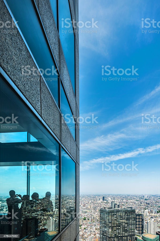 Silhouettes of people in an office tower in Tokyo stock photo