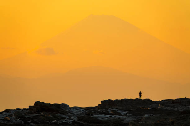 Silhouettes of people with Mt. Fuji in dusk stock photo
