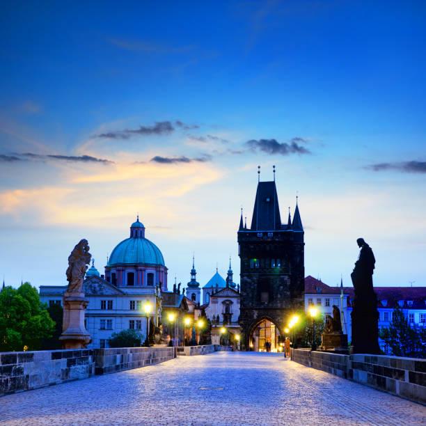Silhouettes of Prague Charles bridge at sunrise, Prague, Czech Republic. Composite photo bohemia czech republic stock pictures, royalty-free photos & images
