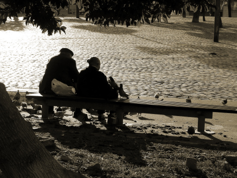 Silhouettes of retired couple