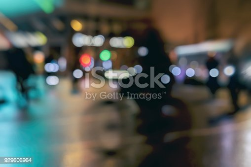 929609038istockphoto Silhouettes of riding Cyclists in traffic on city, night, abstract, motion blur, bokeh 929606964
