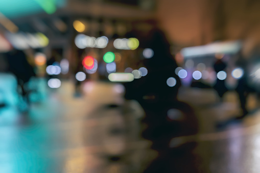 929609038 istock photo Silhouettes of riding Cyclists in traffic on city, night, abstract, motion blur, bokeh 929606964
