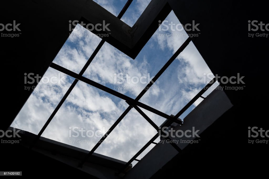 Silhouettes of roof beam  look up in the blue sky. stock photo