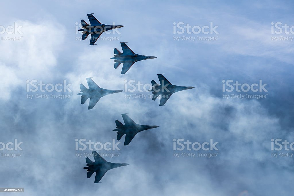 Silhouettes of russian fighter aircrafts SU-27 in the sky Silhouettes of russian fighter aircrafts SU-27 in the sky 2015 Stock Photo