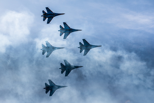 Silhouettes Of Russian Fighter Aircrafts Su27 In The Sky Stock Photo - Download Image Now