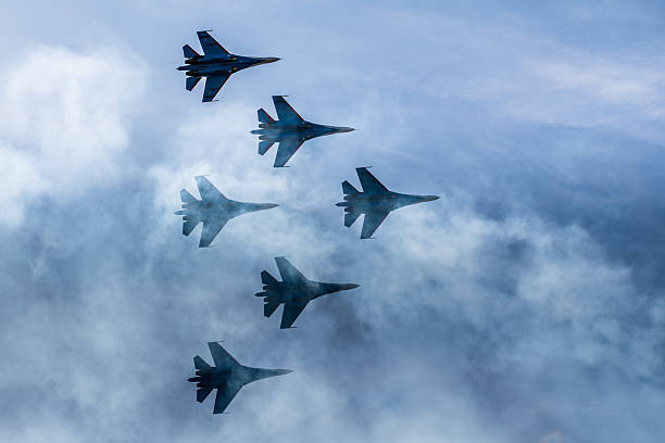 Silhouettes of russian fighter aircrafts SU-27 in the sky Silhouettes of russian fighter aircrafts SU-27 in the sky air force stock pictures, royalty-free photos & images