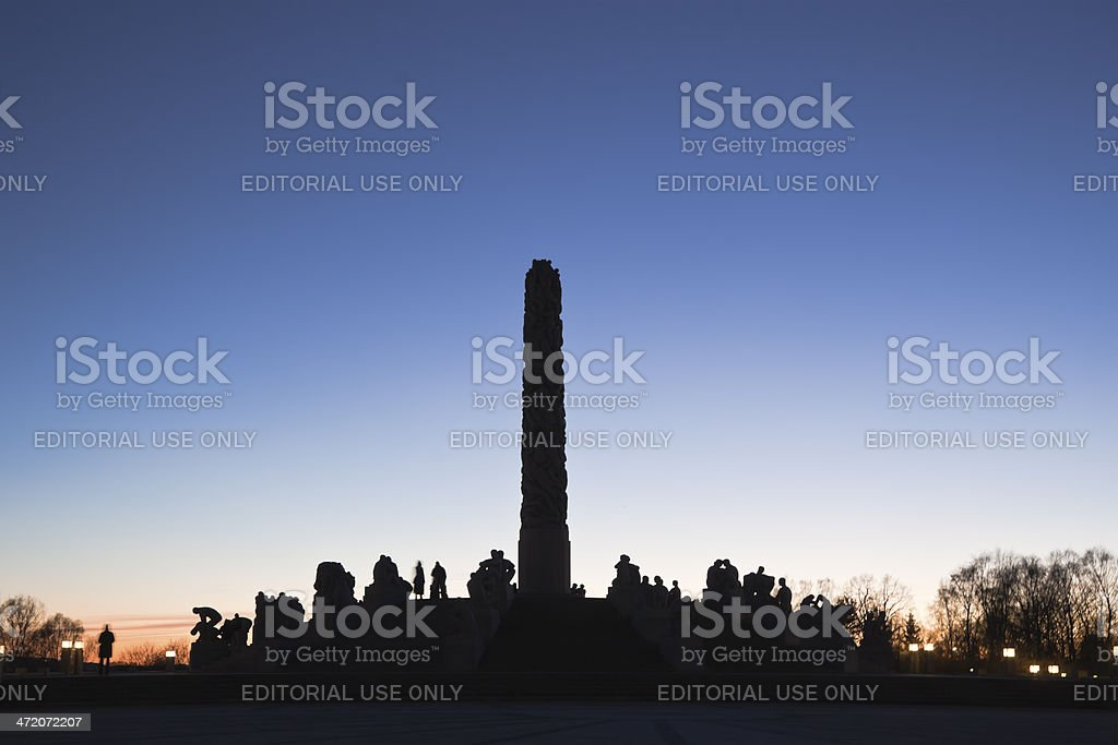 Silhouettes of sculptures and people. stock photo
