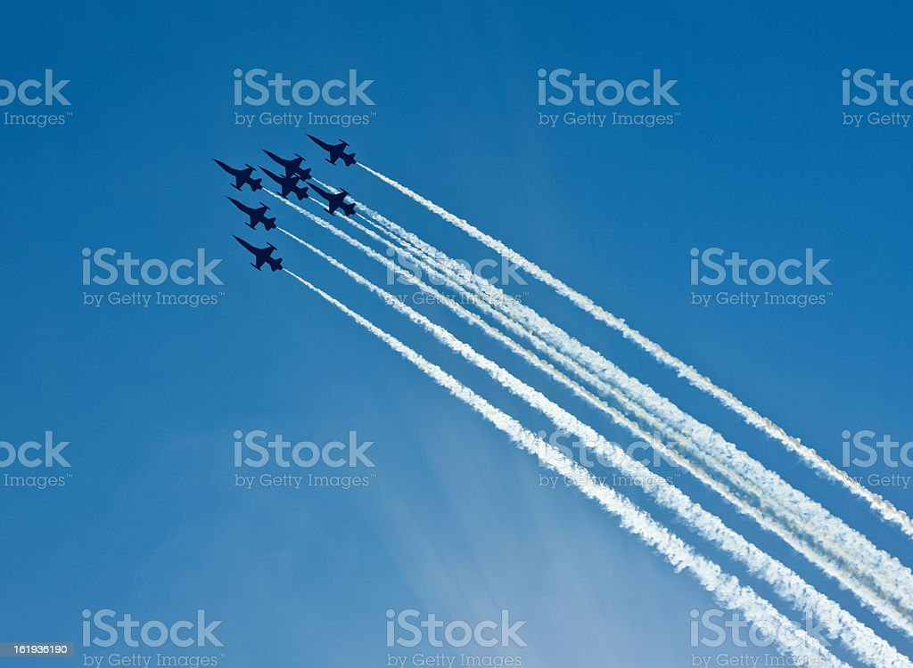 Silhouettes of seven fighter planes with smoke in airshow stock photo