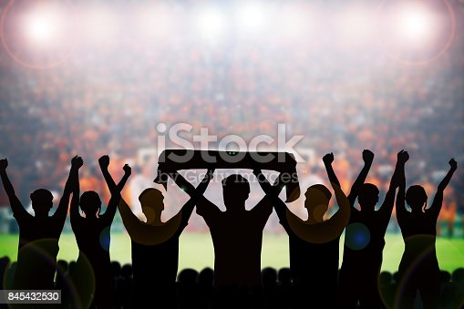 istock silhouettes of Soccer fans in a match and Spectators at football stadium 845432530