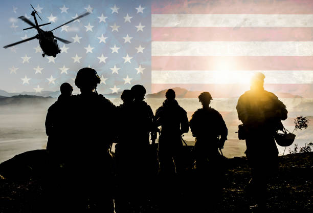 Silhouettes of soldiers during Military Mission against American flag background Silhouettes of soldiers during Military Mission against American flag background Afghanistan stock pictures, royalty-free photos & images
