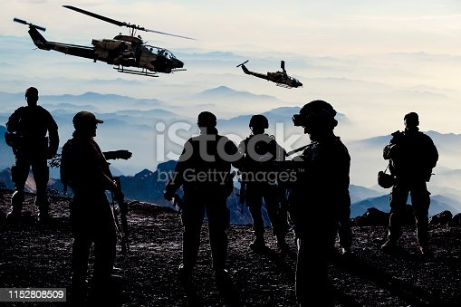 istock Silhouettes of soldiers during Military Mission at dusk 1152808509