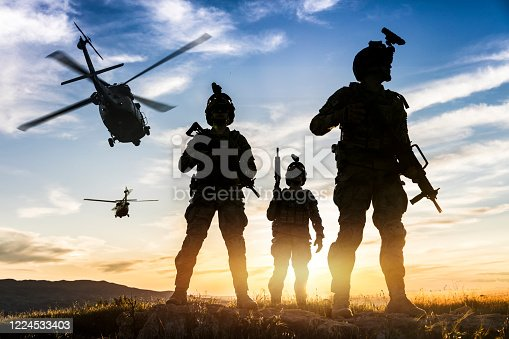 istock Silhouettes of soldiers during Military Mission at sunset 1224533403
