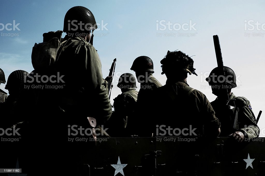 Silhouettes of soldiers going to war royalty-free stock photo