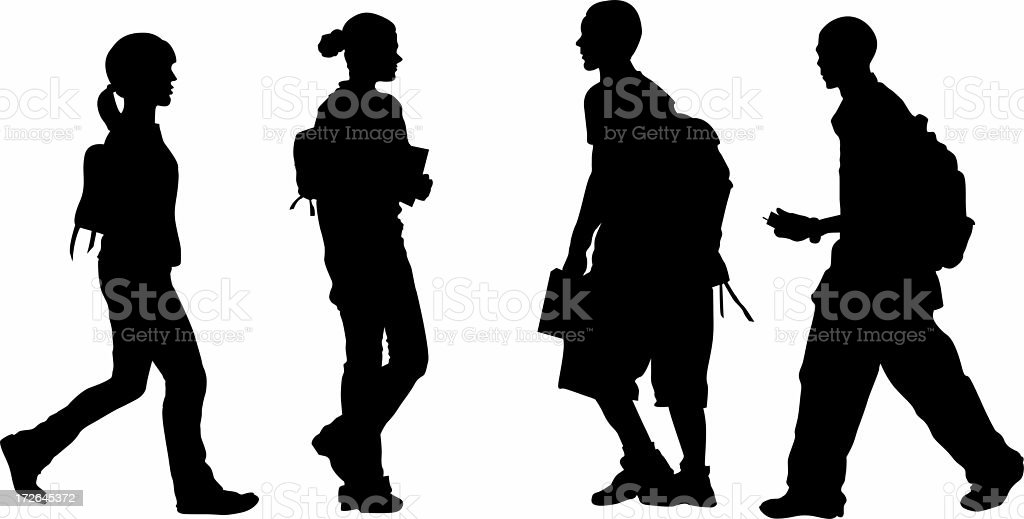 Silhouettes of students carrying backpacks and supplies stock photo