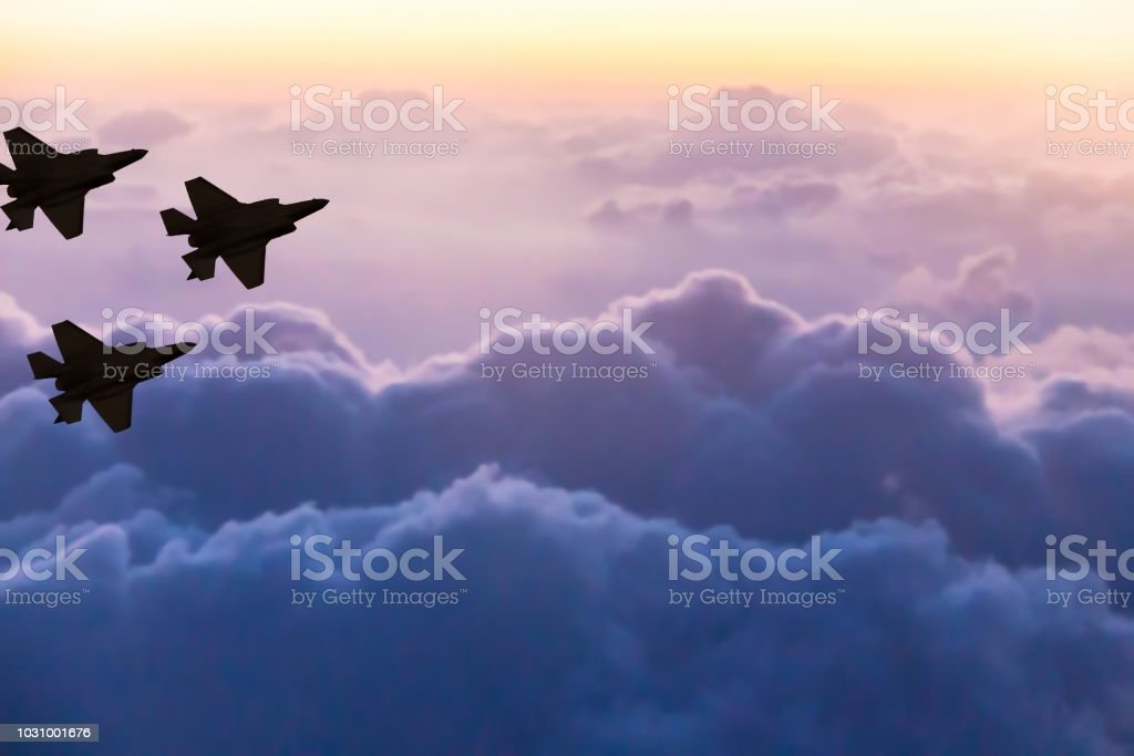 Silhouettes of three F-35 aircraft on sunset sky background Silhouettes of three F-35 aircraft on sunset sky background Air Force Stock Photo