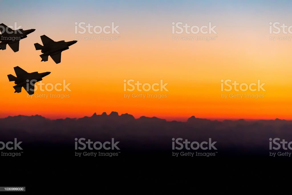 Silhouettes of three super modern fighter-bomber aircraft on sunset sky background Silhouettes of three super modern fighter-bomber aircraft on sunset sky background Air Force Stock Photo