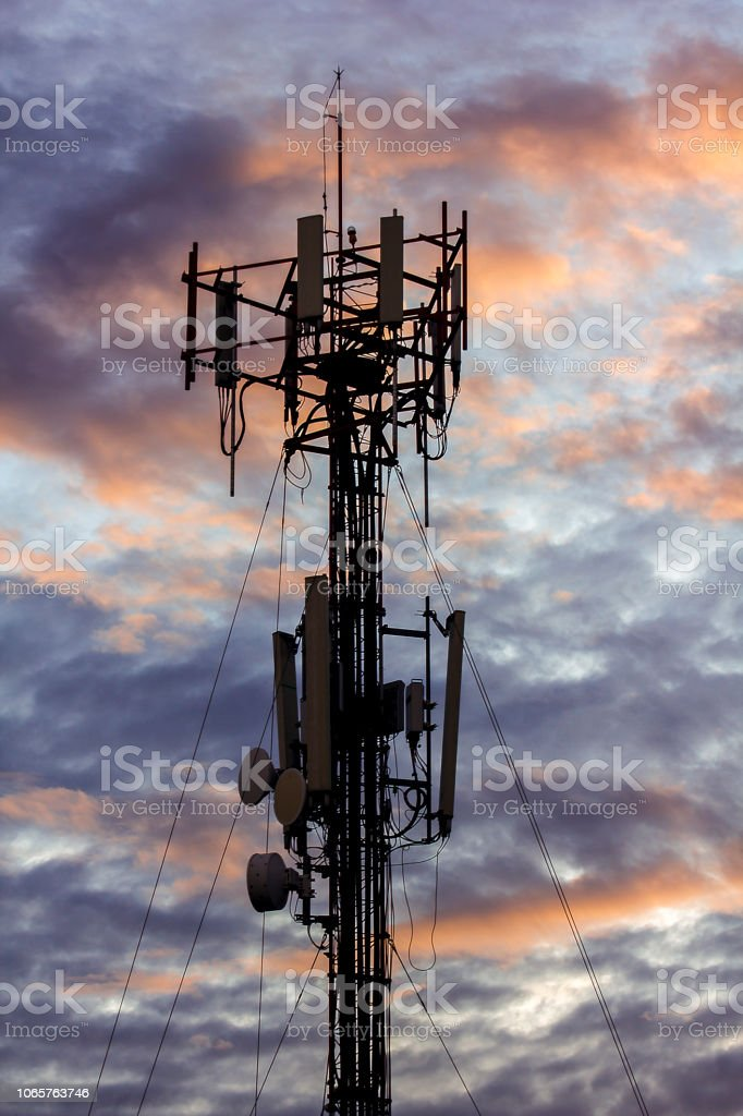 Silhouettes of tower antenna. stock photo
