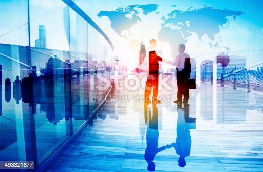 istock Silhouettes of Two Businessman Shaking Hands 493321677