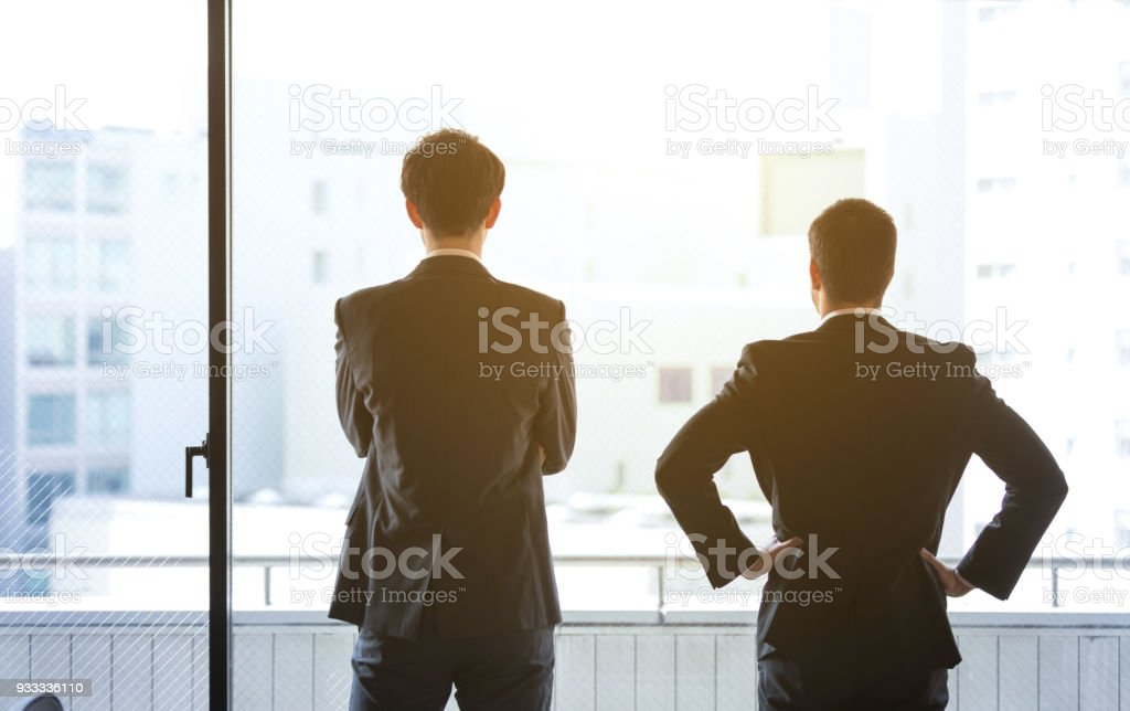 Silhouettes of two businessperson. stock photo