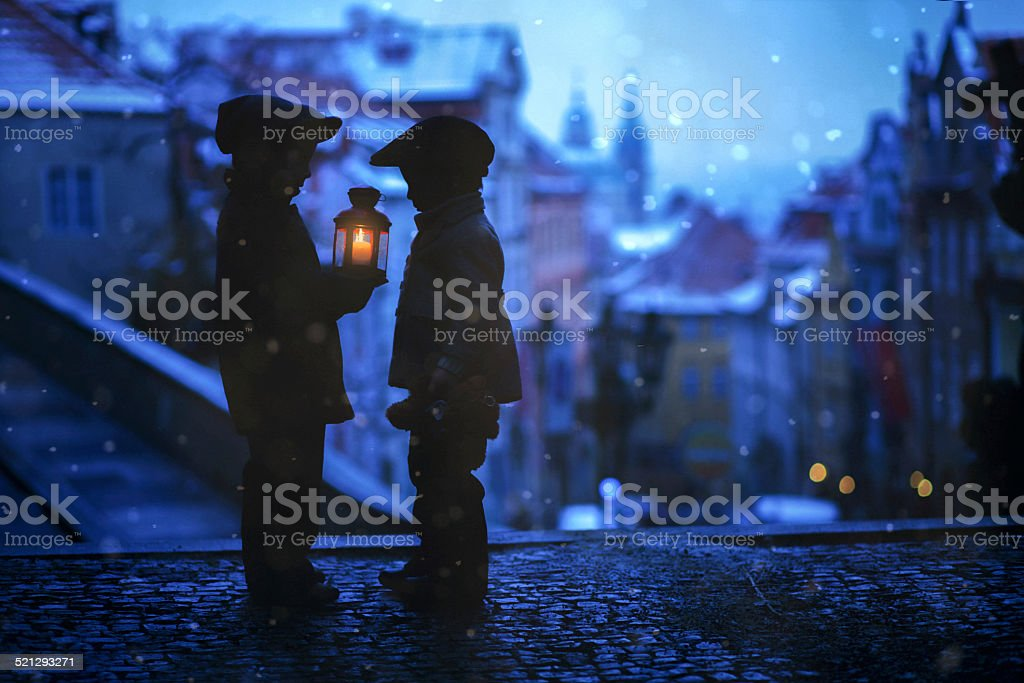 Silhouettes of two kids, standing on a stairs, holding lantern stock photo