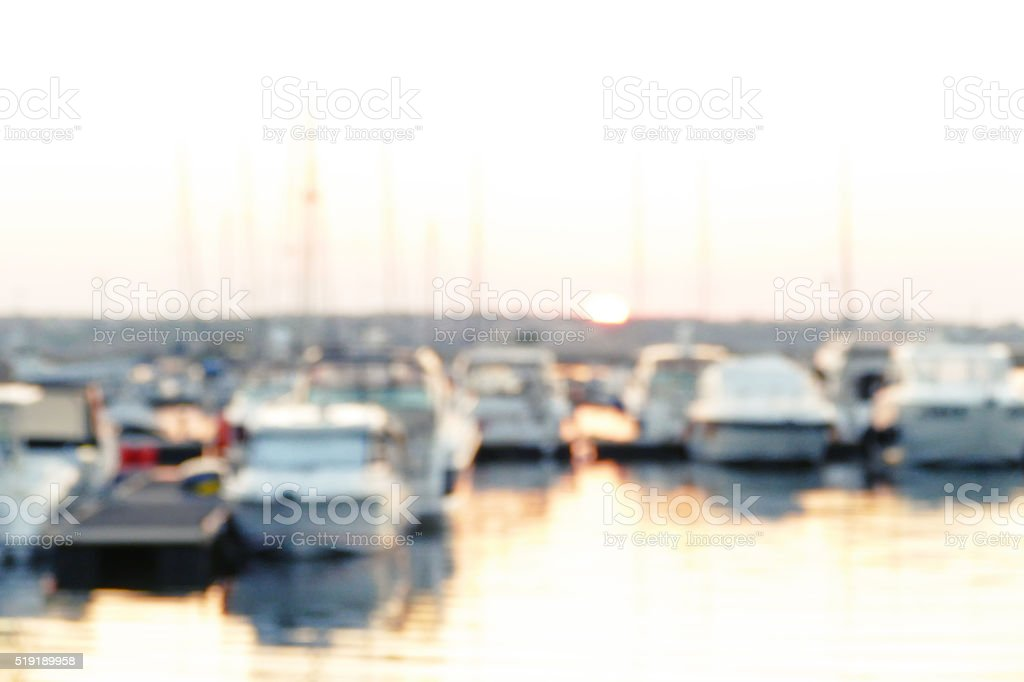 Silhouettes of yachts on a quay stock photo